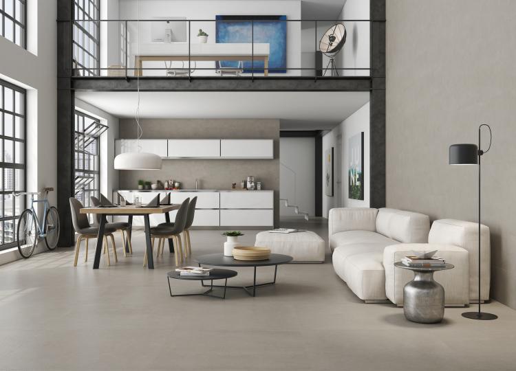 Puristischer, Eleganter Wohnraum Mit Essmöglichkeit, Küche Und Wohnzimmer  Auf Schlichten Bodenfliesen.